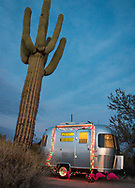 An Airstream camper trailer is decorated with holiday lights at a campsite in Organ Pipe National Monument, Arizona.