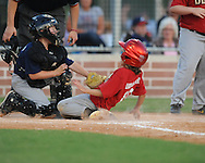 The Diamondbacks' Wilkes Davis is safe at home as Whitman Rowland applies the tag in Oxford Park Commission baseball action at FNC Park in Oxford, Miss. on Tuesday, May 18, 2010.