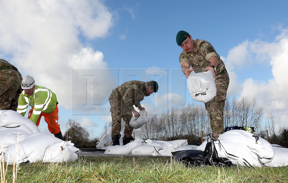 © Licensed to London News Pictures. 07/02/2014. Somerset, UK. The Royal Marines help with relief attempts during the floods in Moorland Somerset today 7th February 2014. Photo credit : Jason Bryant/LNP