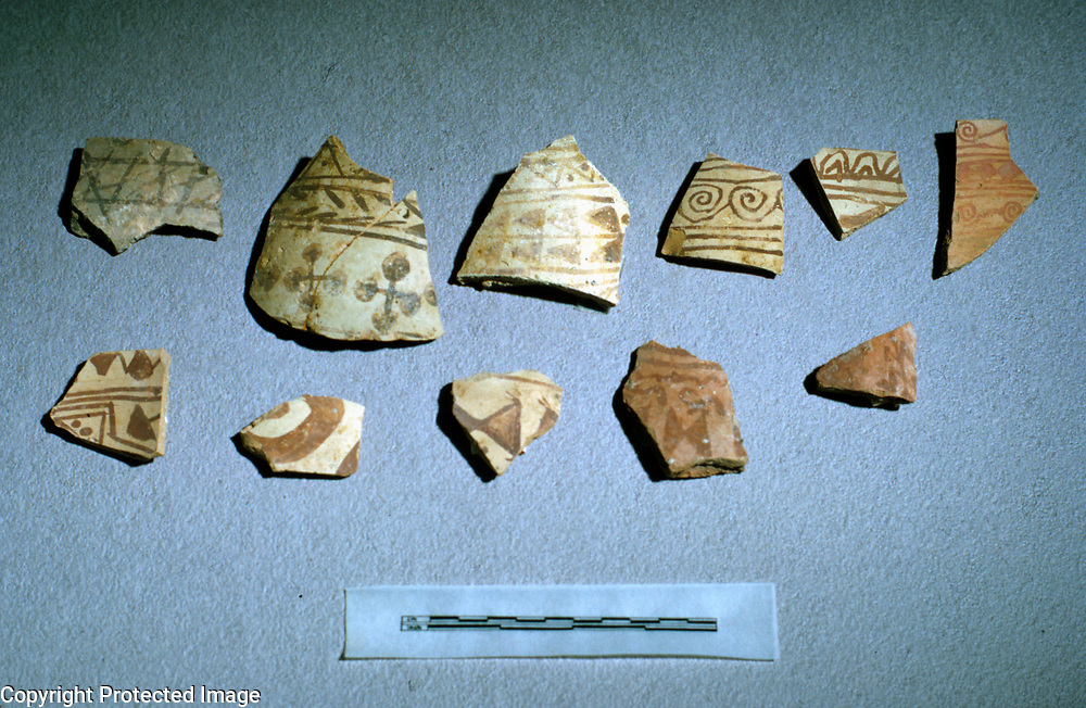 1965<br /> Plain wares, including large whole limestone tempered storage jars from the later Iron Age ca. 600 CE, were found in abundance, but there was also a series of buff ware with painted designs in black or two shades of red. Dot-tipped crosses, scrolls and connected triangles were popular motifs. <br /> Photo: H. Klapper