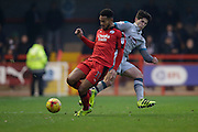 Zak Mills (12) and Jordan Roberts (11) clash during the EFL Sky Bet League 2 match between Crawley Town and Grimsby Town FC at the Checkatrade.com Stadium, Crawley, England on 26 November 2016. Photo by Jarrod Moore.