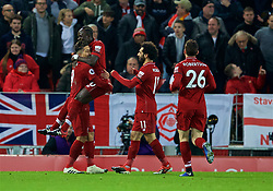 LIVERPOOL, ENGLAND - Saturday, December 29, 2018: Liverpool's Roberto Firmino celebrates scoring the first goal with team-mates during the FA Premier League match between Liverpool FC and Arsenal FC at Anfield. (Pic by David Rawcliffe/Propaganda)