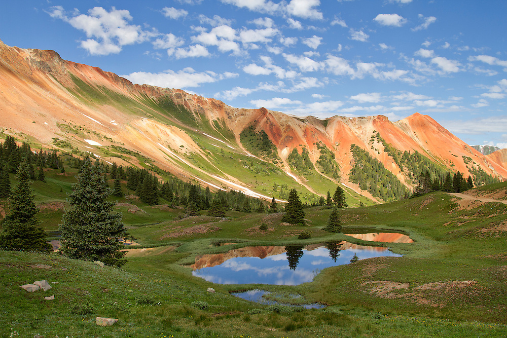 Red Mountain is a set of three peaks in the San Juan Mountains of western Colorado in the United States, about 5 miles south of Ouray. The mountains get their name from the reddish iron ore rocks that cover the surface.