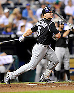 June 23, 2008; Kansas City, MO, USA; Colorado Rockies left fielder Matt Holliday (5) hits a lead off double to right field in the eighth inning against Kansas City Royals at Kauffman Stadium.  The Royals defeated the Rockies 8-4. Mandatory Credit: Peter G. Aiken-US PRESSWIRE