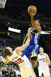 October 29, 2010; Oakland, CA, USA;  Golden State Warriors small forward Rodney Carney (25) is fouled by Los Angeles Clippers power forward Blake Griffin (32) on a shot during the fourth quarter at Oracle Arena. The Warriors defeated the Clippers 109-91.
