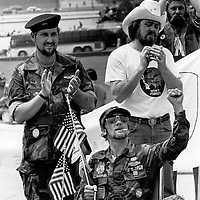 Vietnam era veterans applaud during a protest on the steps of the U.S. Capitol in Washington, DC on May 13, 1982 calling for health benefits from veterans suffering from the effects of the defoliant, Agent Orange.