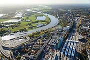 Nederland, Gelderland, Arnhem, 24-10-2013; centrum van de stad met station Arnhem Centraal met nieuwe stationshal, ontwerp UNStudio. Naast het station de kantoortorens van Essent en Arcadis. Rivier de Neder-Rijn.<br /> Central Station Arnhem with new  building.<br /> luchtfoto (toeslag op standaard tarieven);<br /> aerial photo (additional fee required);<br /> copyright foto/photo Siebe Swart.