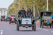 Passing Buckinham Palace and the Mall - Bonhams London to Brighton Veteran Car Run celebrates the 122nd anniversary of the original Emancipation Run of 1896 which celebrated the passing into law the Locomotives on the Highway Act so raising the speed limit for 'light automobiles' from 4mph to 14mph and abolishing the need for a man to walk in front of all vehicles waving a red flag. The Movember Foundation as our Official Charity Partner.