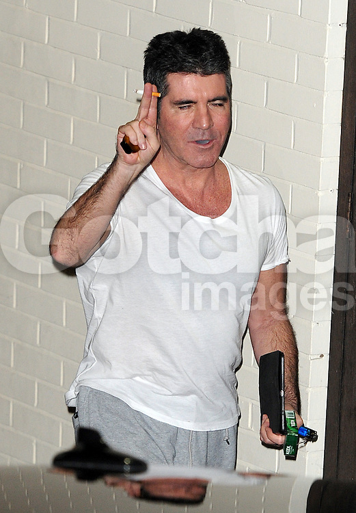 X Factor judge Simon Cowell leaving the X Factor studios in Wembley, UK. 07/12/2014<br />BYLINE MUST READ : GOTCHAIMAGES.COM<br /><br />Copyright by &copy; Gotcha Images Ltd. All rights reserved.<br />Usage of this image is conditional upon the acceptance <br />of Gotcha Images Ltd, terms and conditions available at<br />www.gotchaimages.com