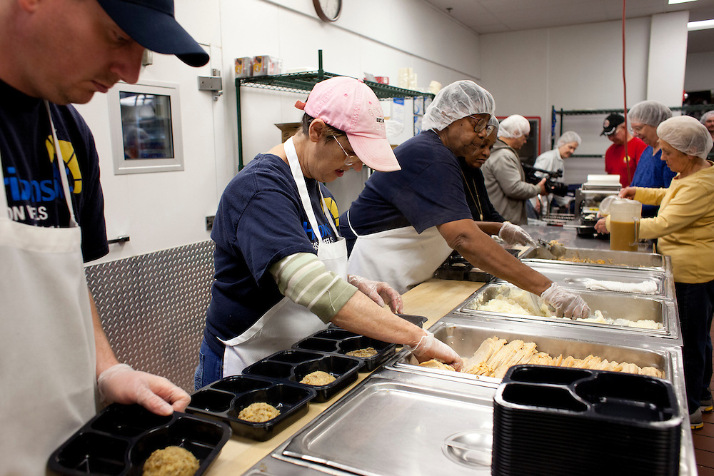 Meals on Wheels volunteers prepare hot meals for homebound seniors at Horizons in downtown Cedar Rapids, Iowa on Thursday, November 19, 2015. The site delivers meals seven days a week around Hiawatha, Marion, Springville, Ely, Mt. Vernon and Lisbon. (Rebecca F. Miller/Freelance for The Gazette)