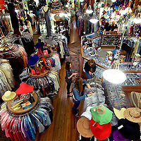 YBOR CITY, FL -- March 6, 2010 -- Shoppers wind their way through racks of vintage clothing at the expansive La France in Ybor City near Tampa, Fla., on Saturday, March 6, 2010.  Tampa and the surrounding area has become a hub for vintage clothing, furniture, and trinkets.