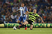 Brighton & Hove Albion centre forward Tomer Hemed (10) tackled by Huddersfield Town midfielder, on loan from Manchester City, Aaron Mooy (10) during the EFL Sky Bet Championship match between Brighton and Hove Albion and Huddersfield Town at the American Express Community Stadium, Brighton and Hove, England on 13 September 2016.