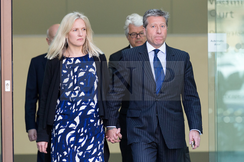 © Licensed to London News Pictures. 16/04/2015. London, UK. DJ, Neil Fox with his wife Vicky leaving Westminster Magistrates Court in London today. appeared charged with nine alleged sexual offences, involving six victims, three of whom were juveniles at the time the alleged offences took place. Photo credit : Vickie Flores/LNP