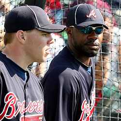 March 16, 2011; Lake Buena Vista, FL, USA; Atlanta Braves first baseman Freddie Freeman (5) and right fielder Jason Heyward (22) talk before a spring training exhibition game against the Boston Red Sox at the Disney Wide World of Sports complex.  Mandatory Credit: Derick E. Hingle