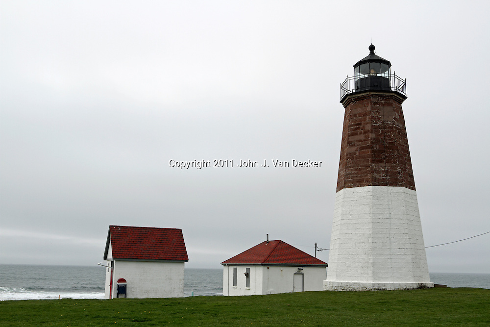 Point Judith Lighthouse on a foggy day. Point Judith, Rhode Island, USA. The lighthouse sits on the far western edge marking the entrance to Narragansett Bay.