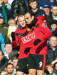 LIVERPOOL, ENGLAND - Saturday, February 20, 2010: Manchester United's Dimitar Berbatov celebrates with team-mate Wayne Rooney after scoring the opening goal against Everton during the Premiership match at Goodison Park. (Photo by: David Rawcliffe/Propaganda)