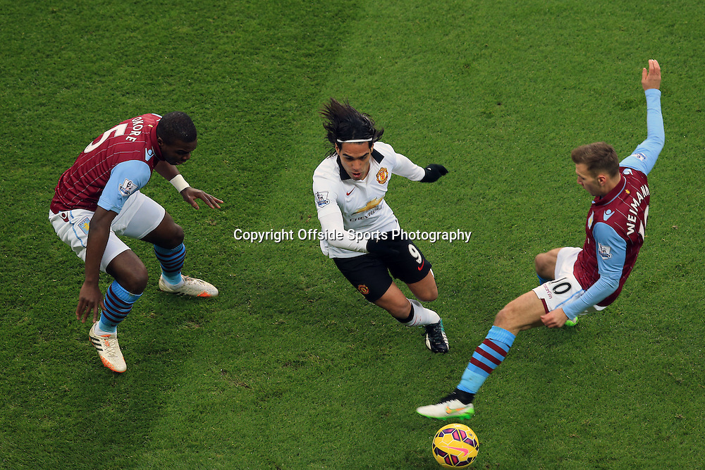 20 December 2014 - Barclays Premier League - Aston Villa v Manchester United - Radamel Falcao of Manchester United in action with Jores Okore and Andreas Weimann of Aston Villa - Photo: Marc Atkins / Offside.