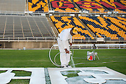 Louis Wright begins painting the field at Eddie Robinson Stadium in advance of Grambling State Universities game against Texas Southern on October 26th in Grambling, Louisiana on October 23, 2013.  (Cooper Neill for The New York Times)