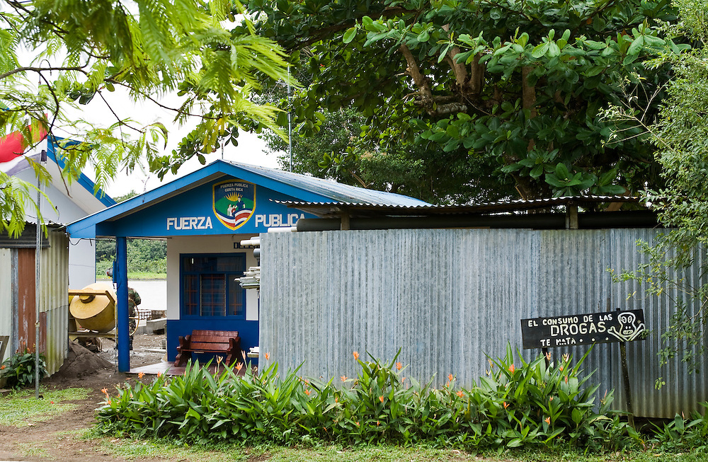The local police station with an anti drugs message posted outside. Located on the Caribbean coast of Costa Rica, Tortuguero is well known for the nesting turtles on its beaches as well as its diverse wildlife along its rivers banks.