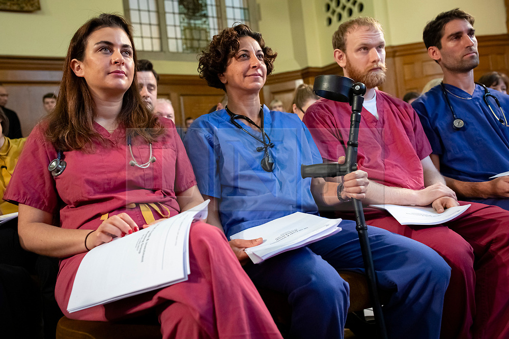 © Licensed to London News Pictures. 27/11/2019. London, UK. NHS doctors with copies of an unredacted  report on trade negotiations with the United States that allegedly affects the NHS at a Labour Party event in Westminster. Photo credit: Rob Pinney/LNP