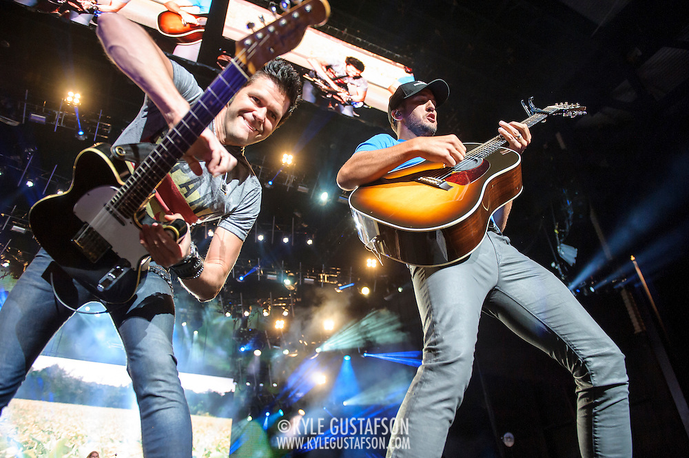 """BRISTOW, VA - May 30th 2014 - Guitarist Michael Carter and Luke Bryan trade guitar licks during a performance of Bryan's hit single """"Rain Is A Good Thing,"""" at Jiffy Lube Live in Bristow, VA. (Photo by Kyle Gustafson / For The Washington Post)"""