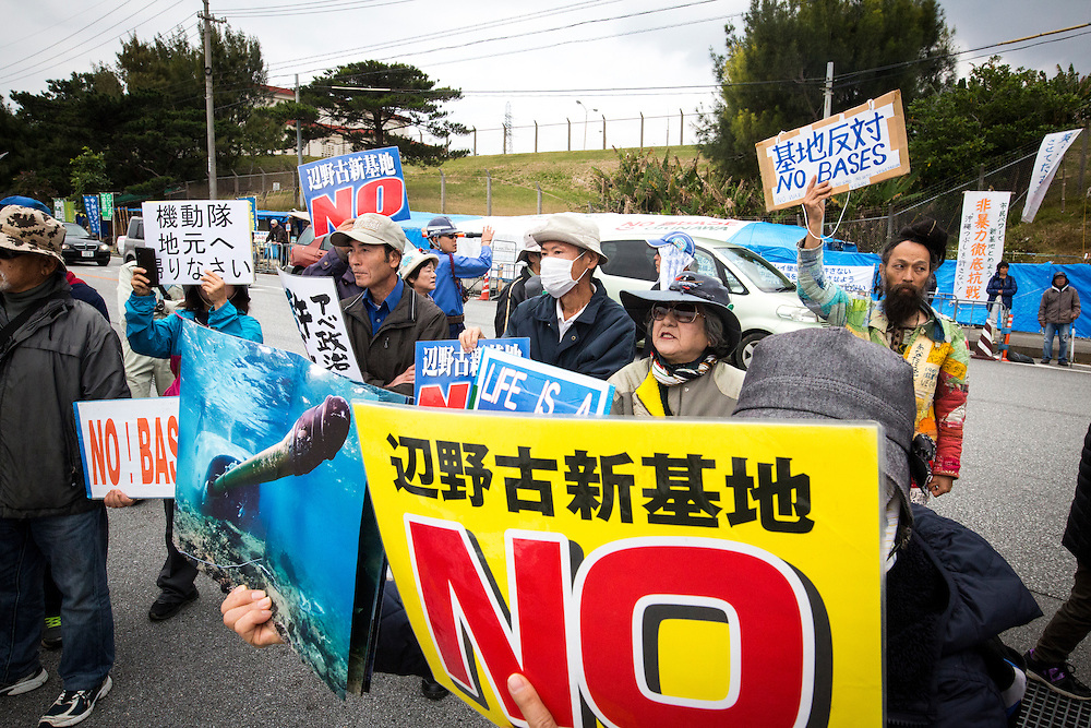 OKINAWA, JAPAN - FEBRUARY 1 : Anti U.S. Base protesters with placards block the cars of US marines in front of the U.S Marine Camp Schwab gate to protest against the construction of the new U.S Marine Airbase in Nago, Okinawa, Japan on Wednesday, February 1, 2017. Okinawa Gov. Takeshi Onaga arrived in the United States on Tuesday, aiming to convey to President Donald Trump's administration local opposition to a plan to relocate a U.S. airbase within the southern island prefecture. (Photo by Richard Atrero de Guzman/NURPhoto)