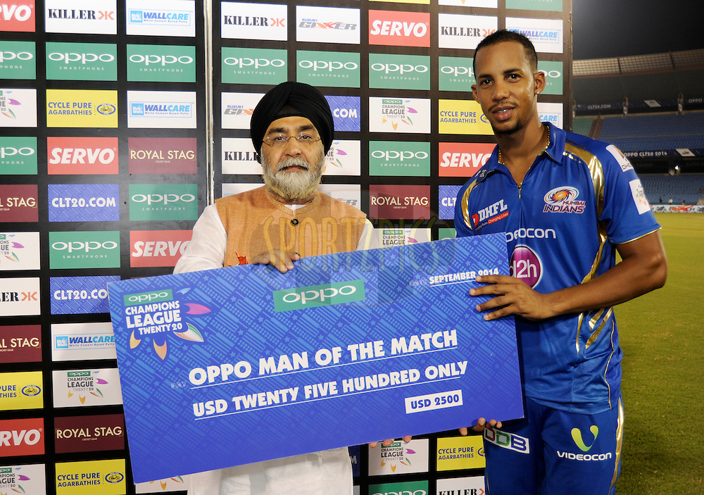 Lendl simmons of Mumbai Indians receives the man of the match award  during the presentation after the qualifier 4 match of the Oppo Champions League Twenty20 between the Mumbai Indians and the Southern Express held at the Chhattisgarh International Cricket Stadium, Raipur, India on the 14th September 2014<br /> <br /> Photo by:  Pal Pillai / Sportzpics/ CLT20<br /> <br /> <br /> Image use is subject to the terms and conditions as laid out by the BCCI/ CLT20.  The terms and conditions can be downloaded here:<br /> <br /> http://sportzpics.photoshelter.com/gallery/CLT20-Image-Terms-and-Conditions-2014/G0000IfNJn535VPU/C0000QhhKadWcjYs
