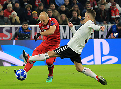 MUNICH, Nov. 28, 2018  Bayern Munich's Arjen Robben (L) takes a shot under the defense from Benfica's Alejandro Grimaldo during a 5th round match in group E of UEFA Champions League between Bayern Munich of Germany and SL Benfica of Portugal, in Munich, Germany, on Nov. 27, 2018. Bayern Munich won 5-1. (Credit Image: © Philippe Ruiz/Xinhua via ZUMA Wire)