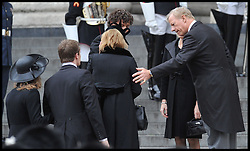 Mark Thatcher, son of Baroness Thatcher puts his arm out to his sister Carol Thatcher as they arrive for the funeral of of their mother Baroness Thatcher at St Paul's Cathedral, London, UK, Wednesday 17 April, 2013. Photo by: Andrew Parsons / i-Images<br /> <br /> File photo - One year ago: Baroness Thatcher died.<br /> On Tue, Apr 8 2014 it will be one year since the Longest-serving UK Prime Minister of the 20th century, the first and only woman to serve in the role to date, died on April 8, 2013  after suffering a stroke.