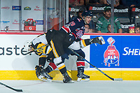 REGINA, SK - MAY 25: Isaac Nurse #11 of Hamilton Bulldogs checks Brady Pouteau #28 of Regina Pats during first period at the Brandt Centre on May 25, 2018 in Regina, Canada. (Photo by Marissa Baecker/CHL Images)