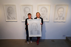 © Licensed to London News Pictures. 17/04/2015. LONDON, UK. Green Party leader Natalie Bennett and artist Annemarie Wright posing open the exhibition of portraits of five party leaders made by Birmingham based artist Annemarie Wright from handwritten text of opinions expressed on social media at Woolff Gallery in London on Friday, 17 April 2015. Photo credit : Tolga Akmen/LNP