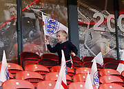 A young England fan with a flag during the U21 UEFA EURO first qualifying round match between England and Scotland at the Riverside Stadium, Middlesbrough, England on 6 October 2017. Photo by Paul Thompson.