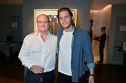 Left to right, THOMAS TRAUTMANN and his nephew CJ JONES at a private view of paintings by Michael Flatley entitled Firedance held at 12 hay Hill, London on 24th June 2015.