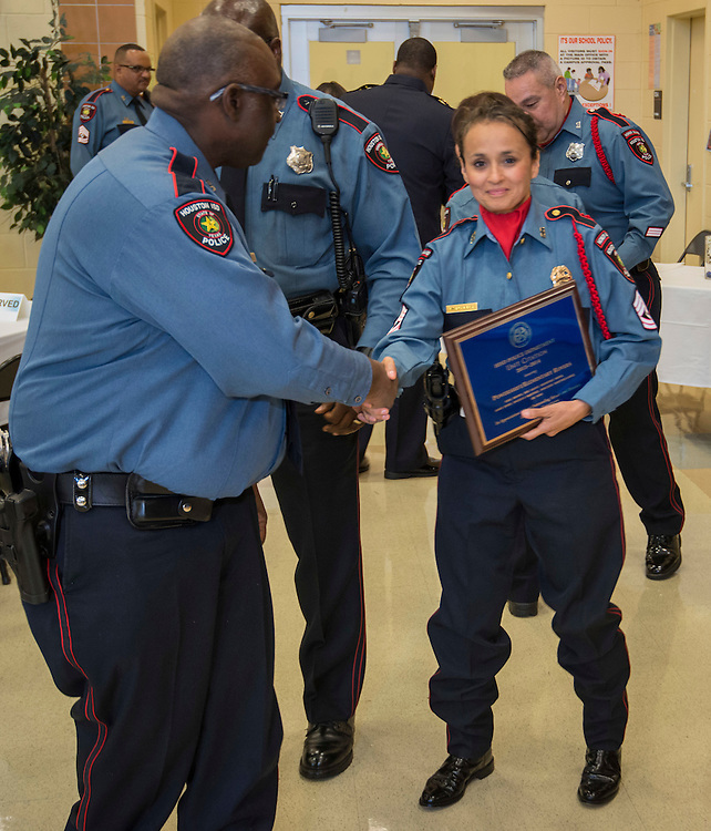 Members of the Power Shift / Elementary Rover team after receiving the Unit Citation of the Year award from Chief Robert Mock during the Houston ISD Police awards banquet at Thompson Elementary School, August 15, 2014.
