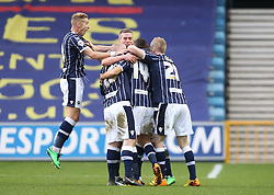 Millwall players mob Ryan Fredericks who scores on his debut - Photo mandatory by-line: Robin White/JMP - Tel: Mobile: 07966 386802 18/01/2014 - SPORT - FOOTBALL - The Den - Millwall - Millwall v Ipswich Town - Sky Bet Championship