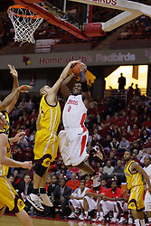 05 December 2009: Jordan Bitzer gets an elbow on Osiris Eldridge and a hand on the ball as Eldridge takes a short jump shot. The Chippewas of Central Michigan are defeated by the Redbirds of Illinois State 75-62 on Doug Collins Court inside Redbird Arena in Normal Illinois.