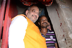April 26, 2017 - Kolkata, West Bengal, India - National President of Bharatiya Janata Party (BJP), Amit Shah visits   party worker's home in slum area at Chetla in Bhabanipur in  Chief Minister Mamata Banerjee's constituency in Kolkata , India on Wednesday , 26th April , 2017.The BJP chief's three-day tour of Bengal will focus  on strengthening the BJP at the grass roots ahead of crucial panchayat or local body elections in the state next year and then the 2019 national election, when Prime Minister Narendra Modi will seek a second term as a part of Booth Chalo Avijan during his three day visit to West Bengal as part of ''Vistaar Yatra'' expansion tour. (Credit Image: © Sonali Pal Chaudhury/NurPhoto via ZUMA Press)