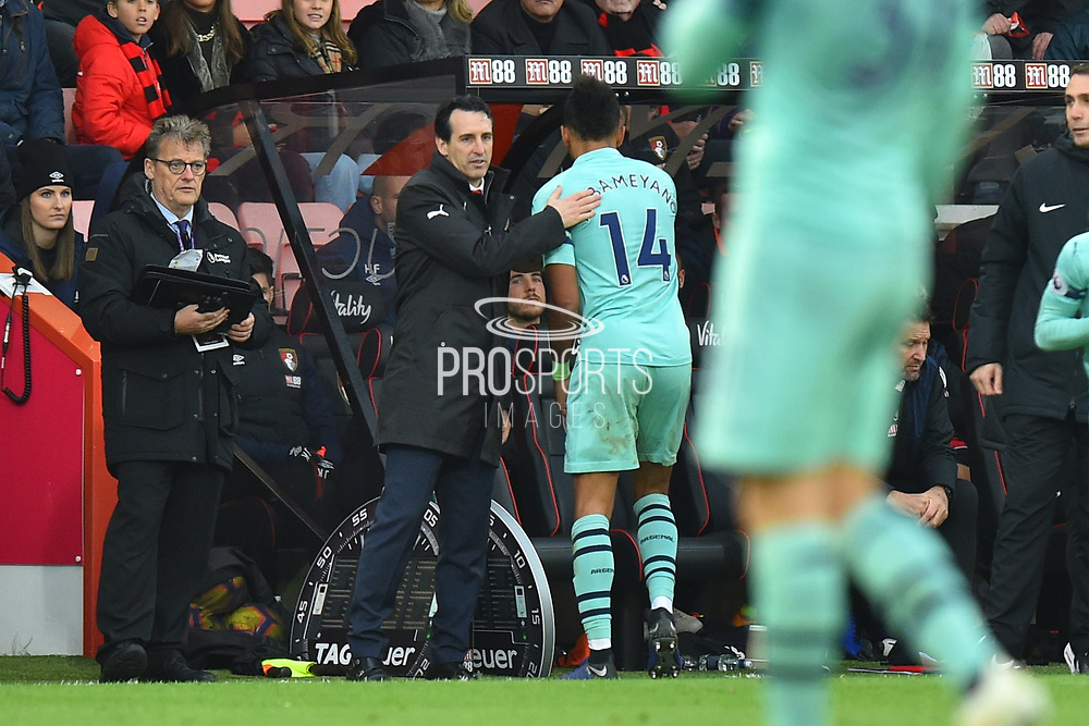 Substitution - Pierre-Emerick Aubameyang (14) of Arsenal is congratulated by Arsenal manager Unai Emery as he is replaced by Edward Nketiah (49) of Arsenal during the Premier League match between Bournemouth and Arsenal at the Vitality Stadium, Bournemouth, England on 25 November 2018.