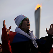 A fan wearing a Russian flag in Olympic Park reacts during Russia's 3-1 loss to Finland in men's ice hockey at the Winter Olympics in Sochi, Russia, Wednesday, Feb. 19, 2014. (Brian Cassella/Chicago Tribune/MCT)