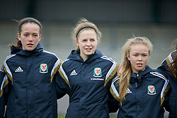 NEWPORT, WALES - Friday, April 1, 2016: Wales' Nieve Jenkins, Megan Balloch and Jasmine Simpson line up for the national anthem before the game against England during Day 1 of the Bob Docherty International Tournament 2016 at Dragon Park. (Pic by David Rawcliffe/Propaganda)