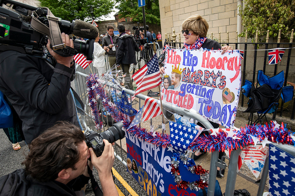 © Licensed to London News Pictures. 16/05/2018. Windsor, UK. Donna Werner, who has travelled from Connecticut in the USA for the Royal Wedding, is interviewed by the media outside Windsor Castle. Prince Harry and Meghan Markle are to be married on Saturday in Windsor. Photo credit: Rob Pinney/LNP