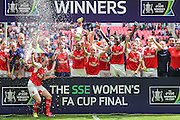 Arsenal players lift the FA Cup during the SSE Women's FA Cup Final match between Chelsea Ladies and Arsenal Ladies at Wembley Stadium, London, England on 14 May 2016. Photo by Shane Healey.