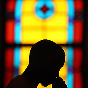 Oct. 17, 2010. Miami, FL. Antowonie Johnson reads at the pulpit from the Bible during Sunday service Oct. 17 during Youth Explosion Day at Macedonia Missionary Baptist church in Coconut Grove. This year, the Church celebrates its 115th anniversary. On this third Sunday of the month, the Church welcomed Reverend Ross F. Pierre, Sr. from Ft. Lauderdale to preach and invited the youth of the church community to host the service. Photo by Brittney Bomnin