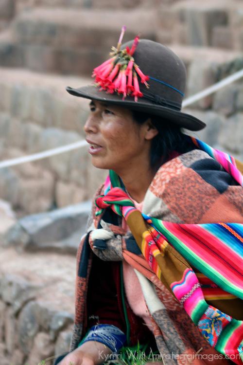 South America, Peru, Pisac. Woman at Inca Písac, terraced ruins at Pisac in the sacred Valley.