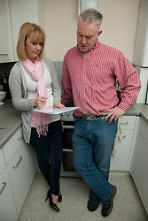 Housing officer with tenant in kitchen.
