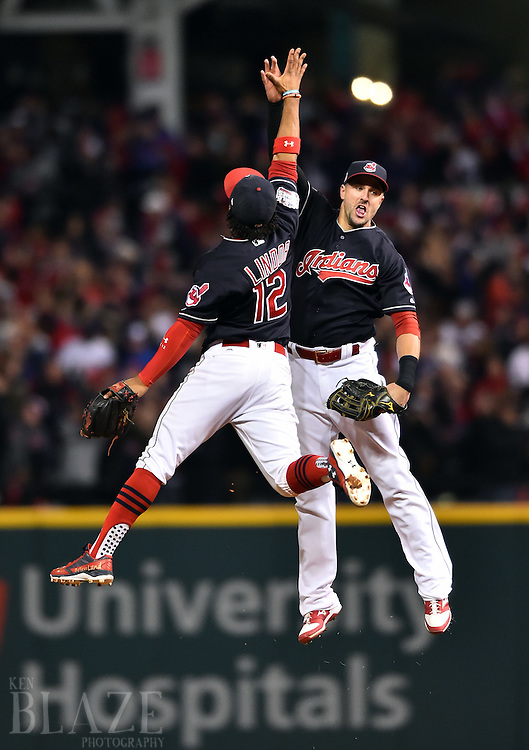 Oct 25, 2016; Cleveland, OH, USA; Cleveland Indians shortstop Francisco Lindor (12) celebrates with right fielder Lonnie Chisenhall after defeating the Chicago Cubs in game one of the 2016 World Series at Progressive Field. Mandatory Credit: Ken Blaze-USA TODAY Sports
