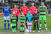 Officials and mascots during the EFL Sky Bet League 2 match between Forest Green Rovers and Macclesfield Town at the New Lawn, Forest Green, United Kingdom on 13 April 2019.