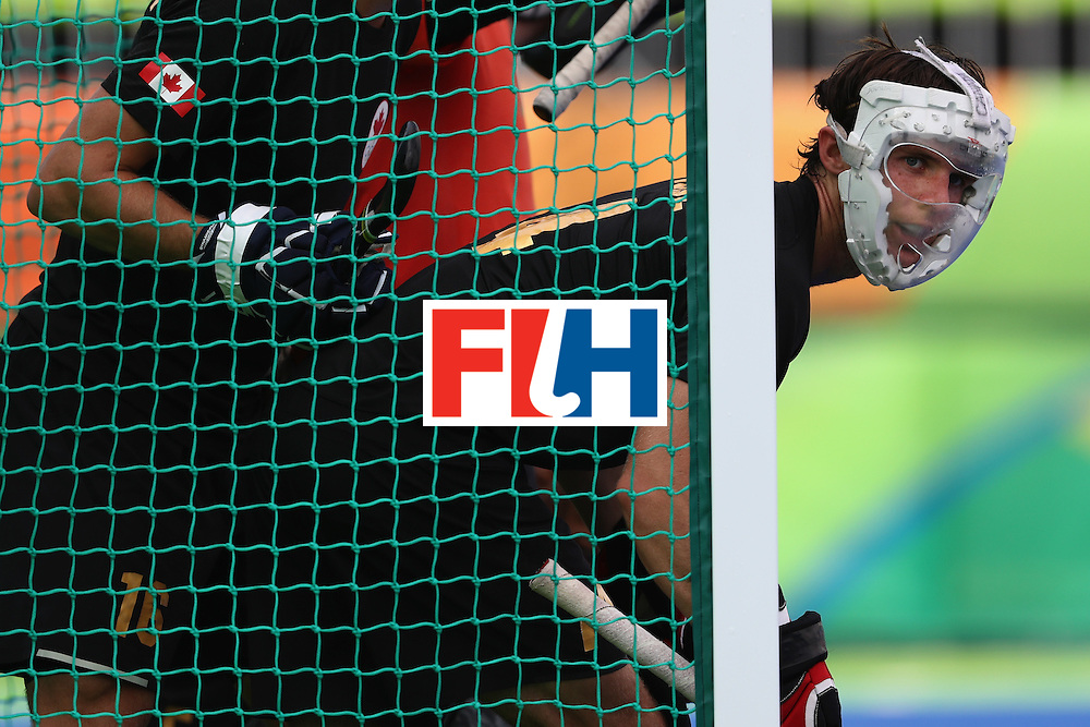 RIO DE JANEIRO, BRAZIL - AUGUST 08:  Scott Tupper #4 of Canada looks out from the goal against Argentina during a Men's Pool B match on Day 3 of the Rio 2016 Olympic Games at the Olympic Hockey Centre on August 8, 2016 in Rio de Janeiro, Brazil.  (Photo by Sean M. Haffey/Getty Images)