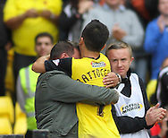 Picture by David Horn/Focus Images Ltd +44 7545 970036<br /> 28/09/2013<br /> Cristian Battocchio of Watford celebrates scoring the winning goal with a fan during the Sky Bet Championship match at Vicarage Road, Watford.