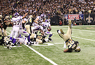 NEW ORLEANS - JANUARY 24: Reggie Bush #25 of the New Orleans Saints fumbles a punt as he is hit by Eric Frampton #37 of the Minnesota Vikings and the ball is recovered by Kenny Onatolu #55 of the Minnesota Vikings at the NFC Championship Game at the Louisiana Superdome on January 24, 2010 in New Orleans, Louisiana. The Saints won 31-28 in overtime to advance to the Super Bowl for the first time. Photo by Tom Hauck.